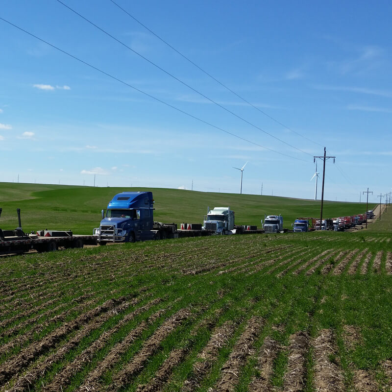 Group of semis by farm field